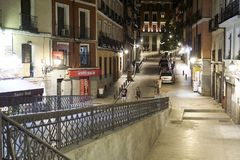 Two people taking a walk on Madrids street at night stock photo