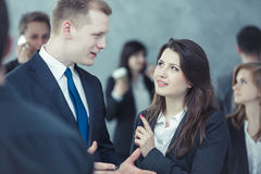 Two people talking in the crowd. People talking while surrounded by the crowd Stock Photos