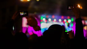 Two People Taping Concert In The Crowd Waving stock footage