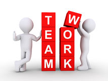 Two people and teamwork concept. Two people form the word TEAMWORK by using blocks Royalty Free Stock Photography