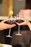 Two people toasting with wine glasses. Royalty Free Stock Photography