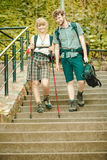 Two people tourists hiking walking on stairs. Stock Photos