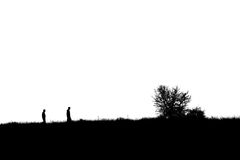 Two people and a tree. Silhouette of two people and a tree Stock Image