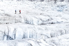 Two people trekking on ice Vatnajokull glacier Stock Photo