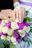 Two people two ring one love. Bouquet flowers wedding hands rings Stock Photography
