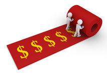 Two people unroll carpet of dollar symbols Royalty Free Stock Image