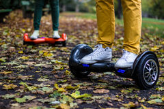 Two people are using hoverboards royalty free stock image