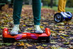 Two people are using hoverboards Stock Photo