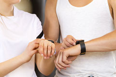 Two people using smart sport watch at workout Royalty Free Stock Photos