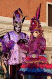 Two people in Venetian costume Stock Images