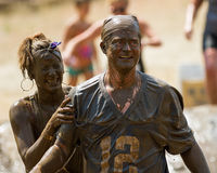 Two people very dirty from the mud pit Royalty Free Stock Photo