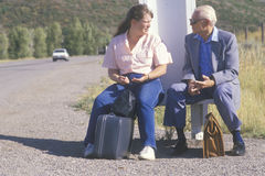 Two people waiting for the bus Royalty Free Stock Image