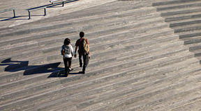 Two people walking Royalty Free Stock Images