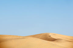 Two people walking in desert dunes Royalty Free Stock Photography