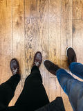 Two People Walking On Hardwood Royalty Free Stock Image