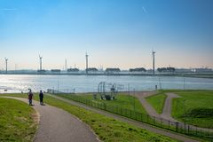 Two People Walking On The Towards The New Waterway, Acees T Royalty Free Stock Photography
