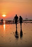 Two people walking during sunset Stock Photography