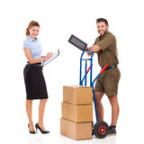 Two people at warehouse Royalty Free Stock Image