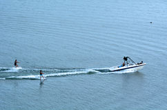 Two people water skiing Royalty Free Stock Image