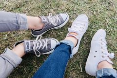 Two People Wearing Converse Allstar Low-top Sneakers Stock Images