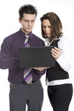 Two people at work Stock Images