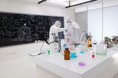 Two people working in a chemistry lab Royalty Free Stock Images