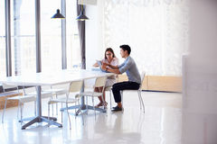 Two people working with digital tablet in empty meeting room Stock Image
