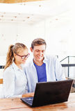 Two people working on laptop. Together Stock Photo
