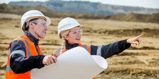 Two people working. Man and woman working in an open-pit Stock Photography