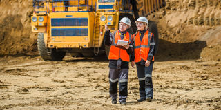 Two people working. Man and woman working in an open-pit Stock Image