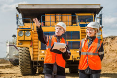 Two people working. Man and women working in an open-pit Royalty Free Stock Photos