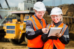 Two people working. Man and women working in an open-pit Royalty Free Stock Photo
