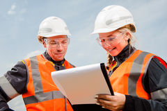 Two people working. Man and women working in an open-pit Royalty Free Stock Image