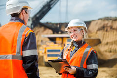 Two people working. Man and women working in an open-pit Royalty Free Stock Images