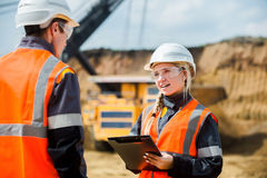 Two people working. Man and women working in an open-pit Stock Images