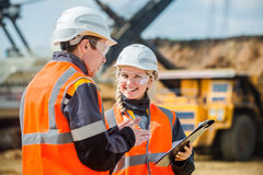 Two people working. Man and women working in an open-pit Stock Photos