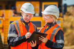 Two people working. Man and women working in an open-pit Stock Photo