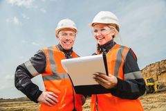 Two people working. Man and women working in an open-pit Stock Photography