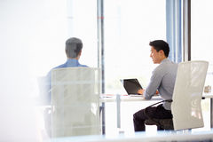 Two people working in a modern office Stock Photos