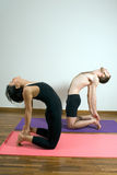 Two People in a Yoga Pose - Vertical Stock Images