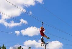 Two people ziplining Foto de archivo libre de regalías