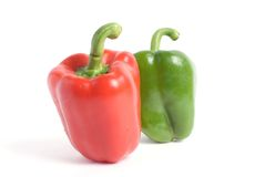 Two pepers. Red and green pepers on white background Royalty Free Stock Photography