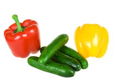 Two pepper and cucumbers isolated Royalty Free Stock Image