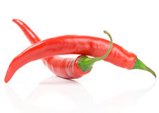 Two peppers forming balanced arch Royalty Free Stock Photos