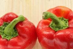 Two peppers. Two fresh peppers on small board royalty free stock images