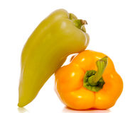 Two peppers over a white background Stock Photography