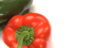 Two peppers. Red green stock footage