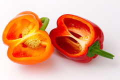 Two peppers. Red and orange peppers opened Royalty Free Stock Images