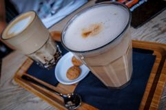 Two perfect glasses of Latte Macchiato. stock images