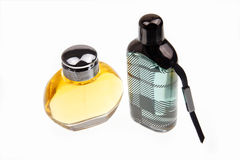 Two perfumes. Man's perfume and women perfume are on the white background Royalty Free Stock Images